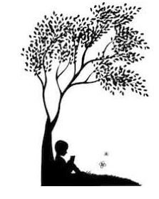 Kid reading under a tree